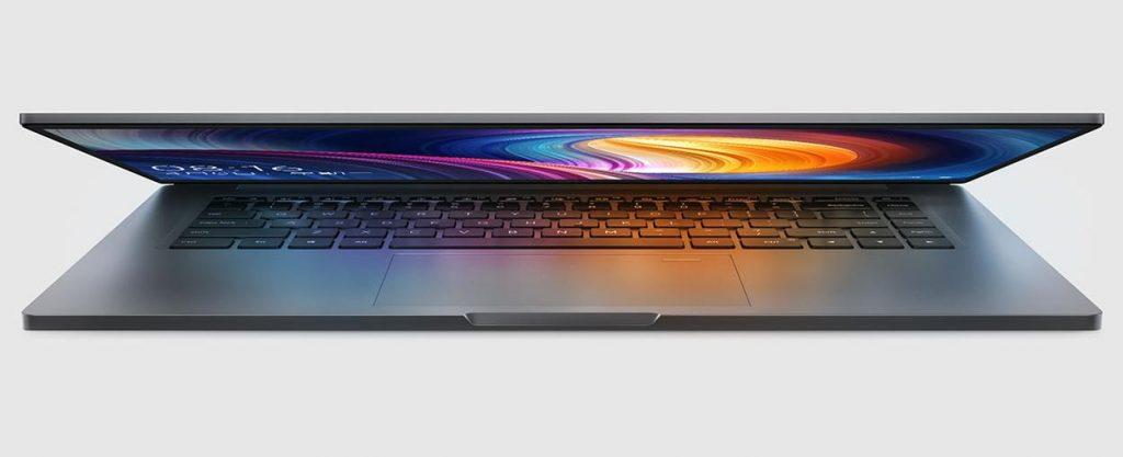 Крышка ноутбука Xiaomi Mi Notebook Pro приоткрыта, вид спереди.